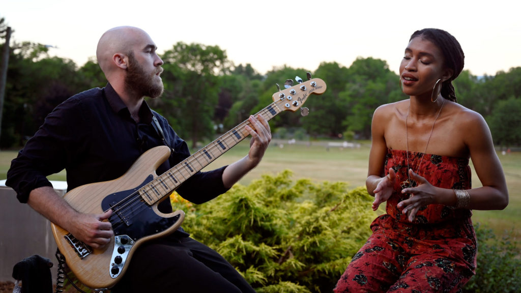 """Vocalist Erica T. Bryan and bassist Tom Sullivan of The New Mosaic perform their song """"Out of Body"""" at Elizabeth Park. Julianne Varacchi/Connecticut Public"""